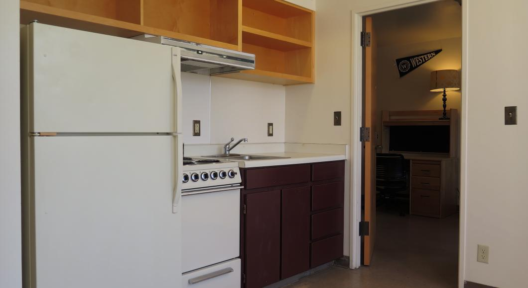 White painted kitchen in an Apartment style dormitory.