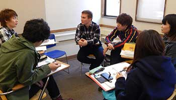 A group of international students work together on their English skills in the classroom