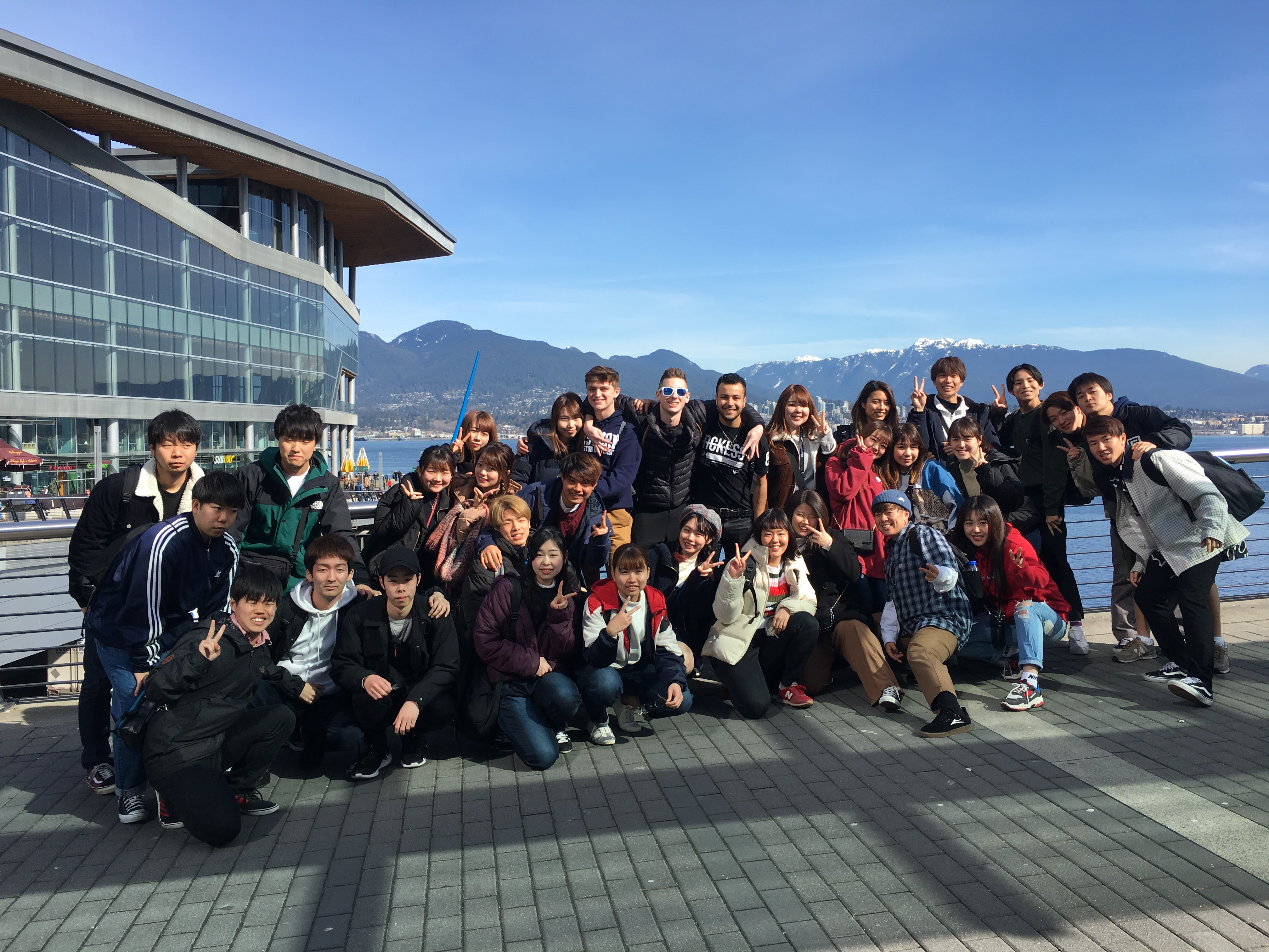 Group of students smiling on an excursion to Vancouver.